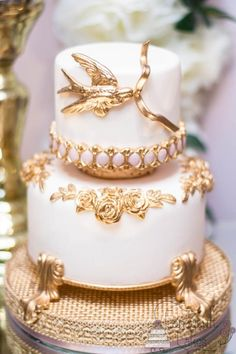 The Fairytale Collection | A small two tier in very soft pink, with lots of gilded moulding, depicting a little bird with a ribbon in his mouth