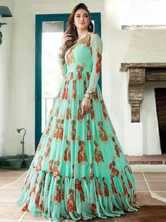 Incredible green digital printed gown online at best shopping price. Shop this latest gown style for diwali celebration. This alluring style set comprises a geoegette gown with matching net dupatta and crepe bottom.