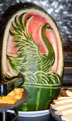 Watermelon Swan Carving _ Food & Fruit Carving! A variety of foods were offered at the Cruise Buffet. I had the opportunity to try foods I'd never been introduced to such as duck and prawn crackers. The cruise was to: Coco Cay Bahamas, St. Maarten, & St. Thomas.