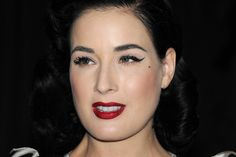 Dita Von Teese Cat Eyes - You can always count on Dita for a flawlessly stunning look. The burlesque show girl showed off her signature classic cat eye and sultry red lips.