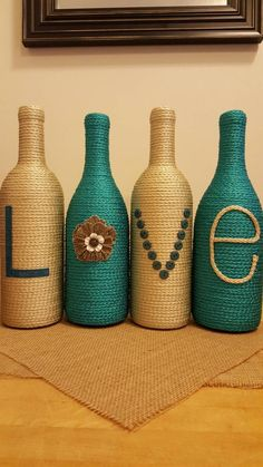 Items similar to Decorated Wine Bottles - Set of 4 'LOVE', upcycled wine bottles, home decor, teal and tan wine bottle decor, wedding centerpiece on Etsy Glass Bottle Crafts, Wine Bottle Art, Diy Bottle, Bottles And Jars, Glass Bottles, Recycled Wine Bottles, Bottle Painting, Recycled Crafts, Jar Crafts
