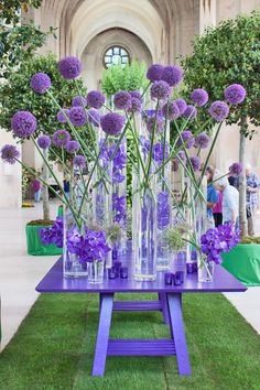 This stunning monochromatic floral display from the British floral artist, Paula Pryke, is a celebration of the royal color. Pryke designed this floral creation for the Guildford Cathedral Flower Gala in LondonThe Color Purple Purple alliums and Vand Purple Flower Arrangements, Floral Centerpieces, Purple Flowers, Purple Rose, Tall Centerpiece, Centerpiece Wedding, Purple Orchids, Wedding Arrangements, Flower Bouquets