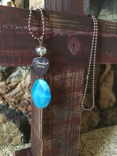 Guitar pick bling necklace with blue stone, chain tassel and ball chain Guitar Pick Bling from Rock & Ramble Rock your fashion- Rock your faith! As seen on
