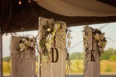 Vintage doors from the bride's great grandparents home, circa 1856, made the perfect alter in this rustic, outdoor wedding!