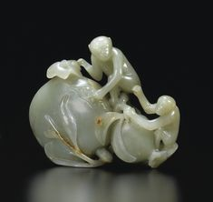 JP: A PALE CELADON AND RUSSET JADE MONKEY AND PEACH, CHINA, QING DYNASTY, 19TH CENTURY