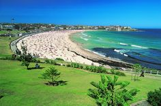 WORLD'S BEST URBAN PARKS | Bondi Beach, SYDNEY | It might not be a park exactly, but who needs shrubbery when you've Australia's most famous beach instead? Surf, skate, indulge in an outdoor work-out at the North Bondi Surf Club, pick up a cooling portion of gelato, and go for a dip in a saltwater swimming pool to leave the corporate world far behind. © Robert Harding/Getty Images