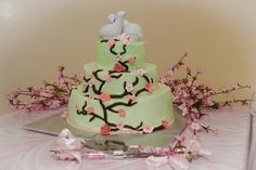Green and pink cherry blossom wedding cake, bird toppers, C. Perkins Photography