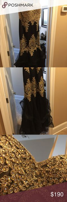 Looking for a prom dress? Look no further! Black and gold styled dress with rhinestones. Mermaid style prom dress, strapless, and a ruffled bottom. Perfect dress to show off your body as well as add a bit of fun to it! David's Bridal Dresses Prom