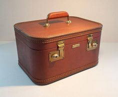 """Vintage train case for toiletries. I own this exact case, just a little more """"gently used"""" than this example."""