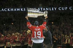 Towes hoisting The Cup