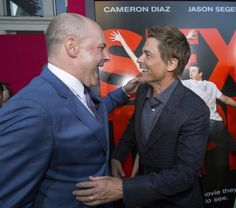 """Cast members Rob Lowe (R) and Rob Corddry greet each other at the premiere of the film """"Sex Tape"""" in Los Angeles, California July 10, 2014. REUTERS/Mario Anzuoni"""