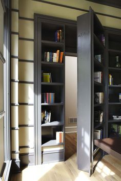 Morgante Wilson Architects installed a custom secret door in this office bookcase.  The bookcase is painted Benjamin Moore Iron Mountain.  The walls are painted Benjamin Moore Brandon Beige.