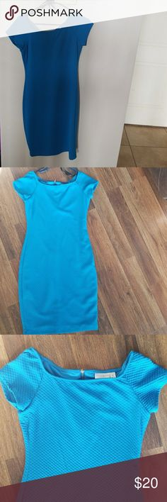 Size 8 Women's Dress This dress is a bright blue, below knee. Beautiful color. Only worn twice. Size 8. 95% Polyester 5% Spandex | lining is 100% Polyester. In excellent condition. Great dress for weddings or cocktail attire parties. **first picture does not capture the color. The other 3 do.** Bisou Bisou Dresses Midi