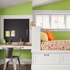A child's compact bedroom with a sloped ceiling was outfitted with built-ins for work, sleep, and storage. | Paint: @benjamin_moore Stem Green (walls) and Seashell (trim)