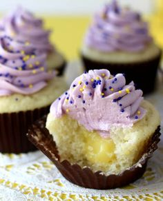 Blueberry Lemon Curd Cupcakes ~T~explains how to make but no recipe, white cake mix, lemon curd and blueberry buttercream.