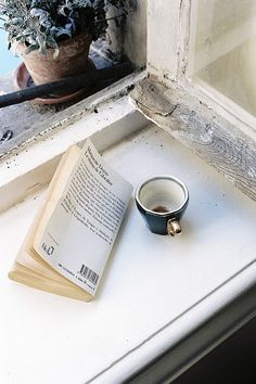 Reading a good book and drinking a hot cup of tea, while sitting next to an open window...