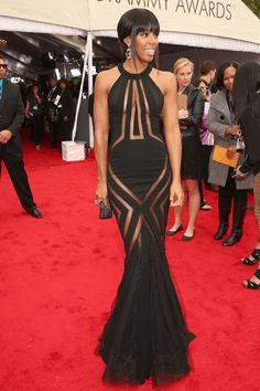 Fashion At The 2013 Grammy Awards.  Kelly you are beautiful.  The dress is tacky.  Not for nothing do they say 'less is more'.