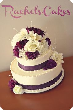WEDDING CAKES WITH PURPLE FLOWERS The cake topper was the bride