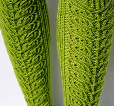 Please note this listing is for a knitting pattern. The socks in this pattern are knit from the top down with US #5 double pointed needles. The pattern calls for approximately 400 yards of worsted weight yarn. The foot of the sock is a twisted stitch rib and the lace panel travels from the ankle to the knee.