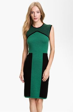 """Figure-flattering color blocks mix with contrast banding and a boxy-knit yoke for an angular update to the classic fitted shift.  Slips on over head.  Approx. length from shoulder to hem: 38"""".  Unlined.  Wool; dry clean."""