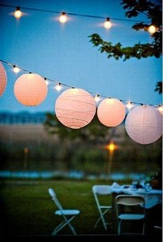 This paper lanterns make an outdoor reception warm and whimsical | Outdoor wedding ideas