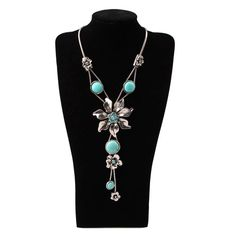 Stylish Turquoise Flower Necklace with rhinestones is a cute piece you can pair with anything , jeans or dresses . Buy as a gift or for yourself ! Bids of $25 and over get a free gift !   Chain Length 19.29 inch   Pendant Length 5.31 inch   Bidding at @$11