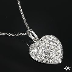 """This """"Domed Heart Pave"""" Diamond Pendant is set in 18k White Gold and shimmers with 56 A CUT ABOVE® Hearts and Arrows Diamond Melee. -"""