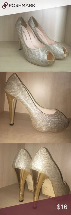 Silver gold platform heels Open toed silver sparkly shoes with gold detail. Heel about 4 inches and platform around 1 and a half inches Shoes Heels