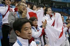 The Japan team applaud as Mao Asada of Japan competes in the women's team short program figure skating competition at the Iceberg Skating Pa...