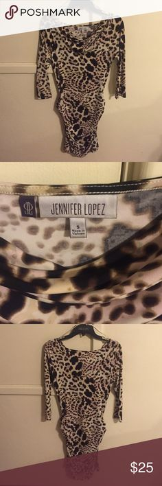 JLO animal skin dress this JLO dress fits your curves perfect! 3/4 quarter length on sleeves and practically brand new aka excellent condition :) size S Jennifer Lopez Dresses Long Sleeve