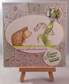 "Easter greeting card - Stamp ""Hedgehog and the Ladybug"" Whimsy Stamps; ""XXL Nest-lies Stitched Ovals"" Crealies; ""Mini Die Flower"" Xcut; ""Butterfly Border"" Yvonne Creations; Felt flower Docrafts; Designerpaper ""Spring Basics"" Maja Design; colored with Derwent Watercolour Pencils"