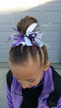 Gymnastics hair.  Braids.