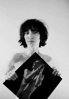 Patti Smith holding Iggy Pop