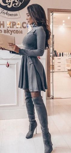 #winter #outfits gray long-sleeve pleated mini dress and gray knee high boots #highheelbootsoutfit