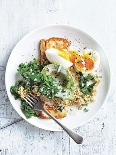 {Creamy quinoa and kale bowl with haloumi and soft boiled egg.}