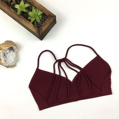 Deep Red Strappy Back Bralette Seamless maroon bralette with strappy back. 92% Nylon 8% Spandex. Brand new. Recommended Cup Fit: XS/S: 32A, 32B, 34A, 34B M/L: 36A, 36B, 38A L/XL: 36C, 38B, 40A,40B Please carefully review each photo before purchase as they are the best descriptors of the item. My price is firm. No trades. First come, first served. Thank you! :) Intimates & Sleepwear Bras