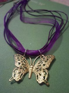 Brass Monarch Butterfly on Purple ribbon necklace in Crafty and Sassy Girls