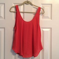 "Beautiful Lush top pretty dark orange colored 100% polyester with a deep round neck in the front and a pointed ""V"" in the back. Top has been gently washed and worn.  No rips no stains. Top is very silky and flowing. Lush Tops Tank Tops"