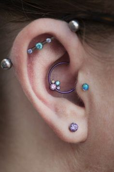 Daith piercing with colorful metal ring. on The Fashion Time http://thefashiontime.com/5-cute-fun-ear-piercing-ideas/#sg41