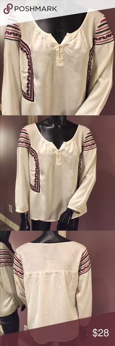 🦅 American Eagle Outfitters Boho Inspired Top 🦅 American Eagle Outfitters Boho Inspired, Long Sleeve Top. Cream colored Rayon Top with Blue and Purple Embroidery. Shoulder to hem measures 24 1/2 inches. Arm pit to arm pit measures 23 1/2 inches. Never worn. ❤️ bundle and save ❤️ American Eagle Outfitters Tops Blouses