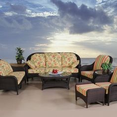 """Veranda Woven Deep Seating Chat Collection with Black Cushions by ShadeTrends. $3165.00. Deep seating. Aluminum frame covered in Tara colored wicker weave. Glass topped oval coffee table is 42""""W x 26""""D x 18""""H. You choose fabric for cushions. Glass topped round side table is 24""""D x 18""""H. 7 piece collection. (2)Chairs are 35""""W x 34""""D. Enjoy your company and relax in your outdoor living room on this 7 piece Veranda Deep Seating Chat Collection. A deepseating loveseat, 3 se..."""