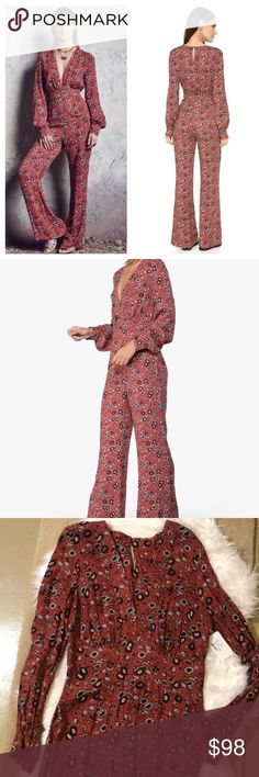 NWT Free People floral rust jumpsuit long sleeve Fun and flowy FP jumpsuit with deep V neck that has two front clasps to close a little extra! Long sleeves, cinched towards the bottom of the bust for a flowy style. Tiny keyhole at the back of the neck with button close. Rust color with floral print. Zip side closure Free People Pants Jumpsuits & Rompers