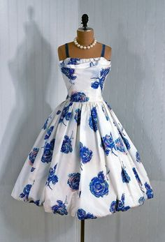 Cocktail Dress: 1950's, watercolor floral taffeta, sculpted shelf-bust bodice with velvet straps, bubble circle skirt, backside over-sized draped bow-tie detailing.