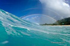 A rainbow over the surf at Pupukea, on the north shore of Oahu, Hawaii by Sean Davey Photography @Flickr