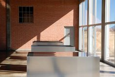 Artillery Shed with milled aluminum sculpture by Donald Judd at the Chinati Foundation in Marfa, Texas…