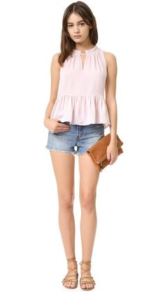 A feminine Rebecca Taylor top with ruffles at the neckline and delicate pleats. Sleeveless. Tie back keyhole.