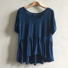 | American Eagle Outfitters Top Pretty short sleeve high/ low flowy top with cute stitch detail around neckline.  In gently used condition. American Eagle Outfitters Tops