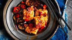 We whip out the wok and visit China for delicious inspiration for this spicy dish, ideal for serving as part of a banquet. The eggplant is great with asparagus added. I also like to steam cubes of silken tofu, place them in the bottom of the serving bowl, then add the sauce.