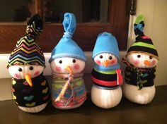 Sock snowman craft.  I helped the kids make these for their teachers for a Christmas gift.        We used rubber bands to make the different sections; they get covered up by the colorful socks so you don't even see them.  The eyes are plastic safety eyes, the nose is felt, the socks were purchased at the dollar store.  We also used eye shadow to give it rosy cheeks. We used stuffing and I put rice at the bottom to give it some weight so it would stand on it's own.  The kids used scraps of…