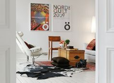layered rugs, and black and white